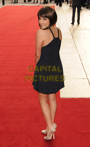"ROXANNE PALLETT.""Righteous Kill"" UK film premiere, Empire Leicester Square, London, England..September 14th, 2008.full length black dress silver shoes looking over shoulder .CAP/CAS.©Bob Cass/Capital Pictures."