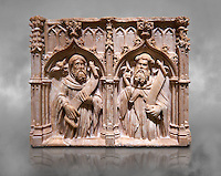 Gothic alabaster relief sculpture of two profits by Pere Oller, circa 1415, from the convent del Carme, Girona, Spain..  National Museum of Catalan Art, Barcelona, Spain, inv no: MNAC 214163. Against a grey textured background.
