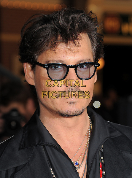 "JOHNNY DEPP .at Walt Disney Pictures' Premiere of ""Pirates of the Caribbean : On Stranger Tides"" held at Disneyland in Anaheim, California, USA, May 7th 2011..4 four portrait headshot glasses black shirt necklaces facial hair moustache mustache goatee .CAP/RKE/DVS.©DVS/RockinExposures/Capital Pictures."