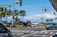 Cars at the intersection of Kamehameha and Waianuenue Avenues in Hilo, Big Island of Hawai'i.