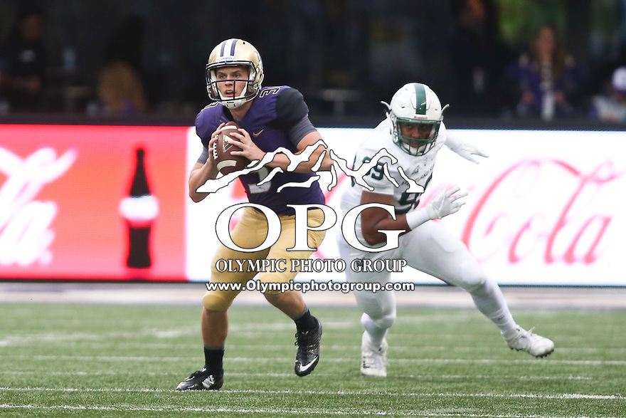 17 September 2016:   Washington quarterback Jake Browning looks down field for an open receiver.  Washington defeated Portland State 41-3 at the University of Washington in Seattle, WA.