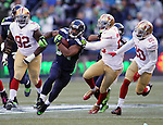 Seattle Seahawks running back Thomas Rawls (34) cuts the corner and runs away from San Francisco 49ers Jimmy Ward (25) and Kenneth Acker (20)  at CenturyLink Field in Seattle, Washington on November 22, 2015.  The Seahawks beat the 49ers 29-13.   ©2015. Jim Bryant Photo. All RIghts Reserved.