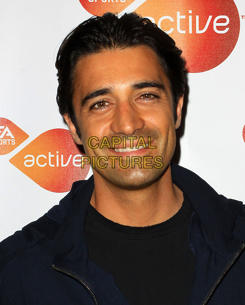 GILLES MARINI.Active For Life event and auction to benefit the March of Dimes Arrivals held At The Warner Drive Studio, Culver City, California, USA..January 8th, 2009.headshot portrait  black blue.CAP/ADM/KB.©Kevan Brooks/AdMedia/Capital Pictures.