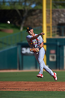 Surprise Saguaros shortstop Aledmys Diaz (4) throws to first during an Arizona Fall League game against the Glendale Desert Dogs on October 24, 2015 at Camelback Ranch in Glendale, Arizona.  Surprise defeated Glendale 18-3.  (Mike Janes/Four Seam Images)