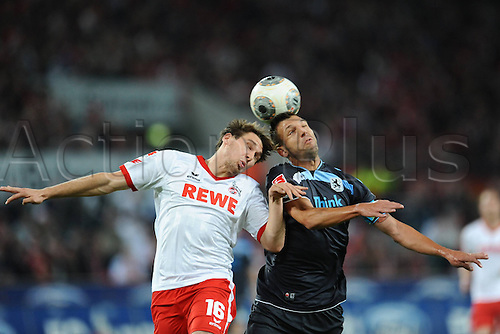 21.10.2013. Cologne, Germany.  FC Cologne versus 1860 Munich. Patrick Helmes Cologne left Guillermo Vallori Munich right
