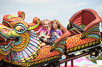 NWA Media/ANDY SHUPE - Fairgoers ride a midway ride Saturday, Aug. 30, 2014, at the Washington County Fair in Fayetteville. The fair concluded Saturday.