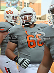 Oklahoma State Cowboys offensive linesman Lane Taylor (68) in action during the game between the Louisiana-Lafayette Ragin Cajuns and the Oklahoma State Cowboys at the Boone Pickens Stadium in Stillwater, OK. Oklahoma State defeats Louisiana-Lafayette 61 to 34.