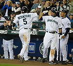 Seattle Mariners' Yuniesky Betancourt is met  by teammates after scoring on a Willie Bloomguist bunt in the seventh inning at Safeco Field in Seattle on June 24, 2007.  The Mariners beat the Reds 3-2. Jim Bryant Photo. ©2010. ALL RIGHTS RESERVED.