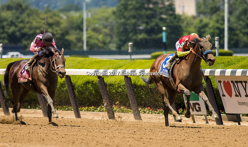 ELMONT, NY - JUNE 10: Abel Tasman #3, ridden by Mike Smith, wins the Acorn Stakes ahead of Salty #8, ridden by Joel Rosario, on Belmont Stakes Day at Belmont Park on June 10, 2017 in Elmont, New York. (Photo by Jesse Caris/Eclipse Sportswire/Getty Images)