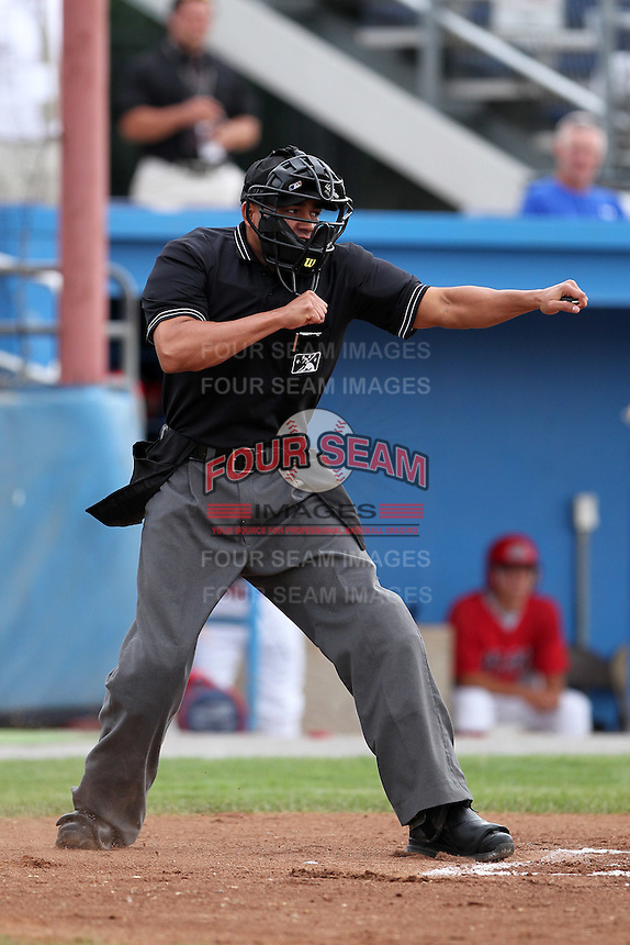 Umpire Ramon Ortiz during a game at Dwyer Stadium in Batavia, New York;  July 18, 2010.  Photo By Mike Janes/Four Seam Images