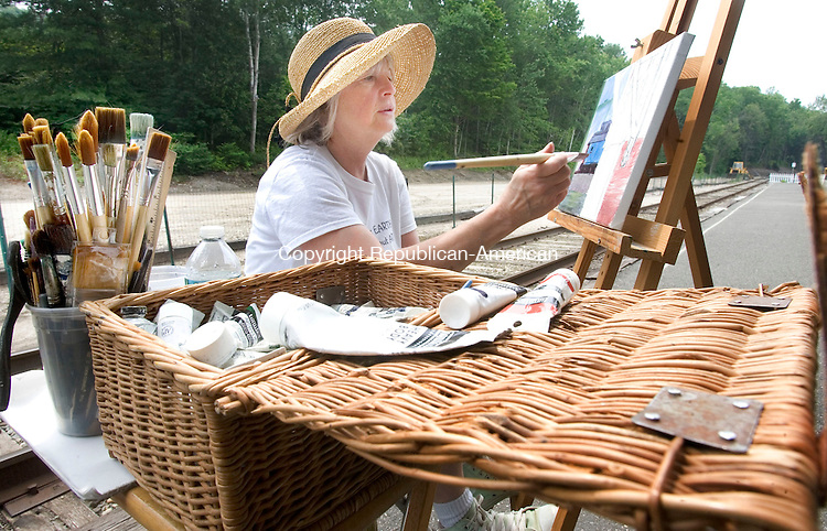 THOMASTON CT. 11 June 2015-061115SV07-Pat Piscapo of Thomaston paints a picture of the train station in Thomaston Thursday. A group of artists spent the afternoon painting outside the train station.<br /> Steven Valenti Republican-American