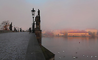 The Charles Bridge or Karluv most, built 1357 - 15th century, and the Vltava river, Prague, Czech Republic. Its construction began under King Charles IV, replacing the old Judith Bridge built 1158'??1172 after flood damage in 1342. This new bridge was originally called the Stone Bridge (Kamenny most) or the Prague Bridge (Prazsky most) but has been the Charles Bridge since 1870. The bridge is 621m long and nearly 10m wide, resting on 16 arches shielded by ice guards. The historic centre of Prague was declared a UNESCO World Heritage Site in 1992. Picture by Manuel Cohen
