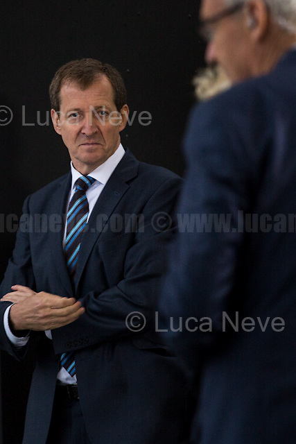 (On the L) Alastair Campbell (British journalist, broadcaster, political aide and author, best known for his work as Director of Communications and Strategy for prime minister Tony Blair between 1997 and 2003).<br /> <br /> London, 28/06/2016. Today, around 5PM, thousands of members of the public gathered in Trafalgar Square under rain showers to protest against the EU Referendum result which is leading the United Kingdom to the so called &quot;Brexit&quot;, in other words to leave the European Union. Around 7:30PM, people started to march spontaneously and peacefully towards Parliament Square. The demonstration ended around 9:30PM in College Green, a little park outside the Houses of Parliament where all the major media set up their portable studios and where politicians, analysts, commentators, experts and others give interviews about the outcome of the recent Referendum, the fallout and to try to forecast the future. While reported on the Channel 4 news that most protestors were 18+ (Which you can find here: https://www.facebook.com/Channel4News/videos/10153853076771939/ ), this was not actually the case. Protestors of all ages were present in significant numbers representing all the generations of the population. Previously, another planned demonstration called &quot;Stand Together: London event&quot; was cancelled &lt;&lt; [&hellip;] on safety grounds after an &quot;unprecedented&quot; response from Londoners. More than 50,000 people were expected to attend a London Stays rally this evening to show that &quot;London stands with Europe&quot;. But organisers today confirmed the protest was cancelled due to safety concerns. City Hall also said the protest had been blocked because the number of people who were planning to attend exceeded Trafalgar Square's safe limit by 40,000. [&hellip;]&gt;&gt; (From the Evening Standard, 28 June 2016, http://bit.ly/2991liM).<br /> <br /> For more information about the demo please click here: http://bit.ly/29dYcjI