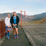 Alma Jenny Árnarsdottir, 13 y.o., and Klaudia Wojciechowska, 13 y.o., schoolchildren. They play football, basketball and volleyball. They are serious about sports: have already participated in competitions for juniors all over the country. I met them as I was walking around Grundarfjörður on October 14th 2013, it was 3 p.m. The sports centre with a swimming pool, a football field, a children's playground and a basketball court is located in this rather small village on a hilltop where rays of sunshine stay the longest and the sound of a bouncing ball reverberates from the surrounding mountains. The weather was sunny, without wind.