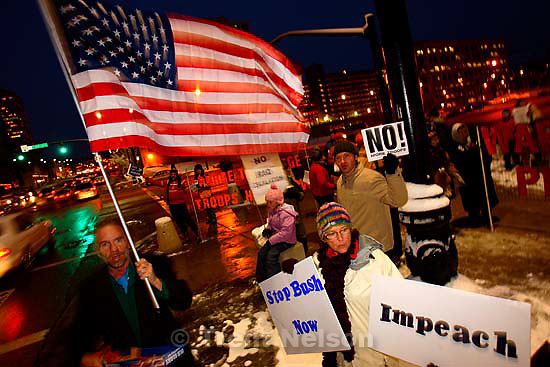 Salt Lake City - About forty people met in front of the Federal Building downtown to protest President Bush's plan to send more than 20,000 additional troops to Iraq. They chanted, &quot;How do we support the troops? Bring them home.&quot;&amp;#xA;; 1.11.2007<br />
