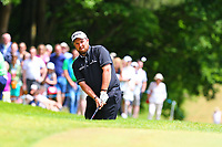 Shane Lowry chips onto the 1st green during the BMW PGA Golf Championship at Wentworth Golf Course, Wentworth Drive, Virginia Water, England on 28 May 2017. Photo by Steve McCarthy/PRiME Media Images.