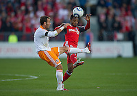 07 May2011: Houston Dynamo midfielder Brad Davis #11and Toronto FC midfielder Julian de Guzman #6 in action during an MLS game between the Houston Dynamo and the Toronto FC at BMO Field in Toronto, Ontario.