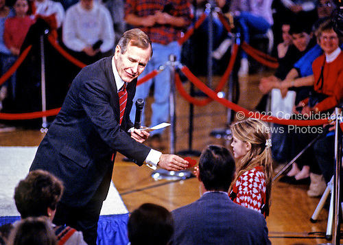 "United States President George H.W. Bush moderates an ""Ask George Bush"" event as he campaigns for reelection at the Hollis/Brookline High School in Hollis, New Hampshire on February 16, 1992 prior to the 1992 New Hampshire Primary.<br /> Credit: Ron Sachs / CNP"