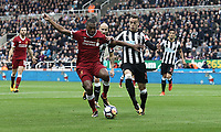Liverpool's Daniel Sturridge holds off the challenge from Newcastle United's Javi Manquillo<br /> <br /> Photographer Rich Linley/CameraSport<br /> <br /> The Premier League -  Newcastle United v Liverpool - Sunday 1st October 2017 - St James' Park - Newcastle<br /> <br /> World Copyright &copy; 2017 CameraSport. All rights reserved. 43 Linden Ave. Countesthorpe. Leicester. England. LE8 5PG - Tel: +44 (0) 116 277 4147 - admin@camerasport.com - www.camerasport.com