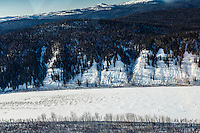 A team runs down the Yukon River after leaving Nulato on the way to the Kaltag checkpoint on Saturday March 12th during the 2016 Iditarod.  Alaska    <br /> <br /> Photo by Jeff Schultz (C) 2016  ALL RIGHTS RESERVED