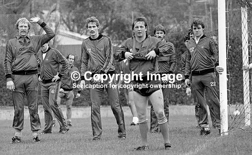 Eric McManus, footballer, goalkeeper, Stoke City FC &amp; N Ireland, left, signals the go-ahead for a corner during a training session prior to N Ireland's November 1980 game against Portugal at Windsor Park. Also prominent in the photo are Billy Hamilton, Burnley FC, Dave McCreeery, Manchester United FC, John McClelland, Mansfield Town FC, Mal Donaghy, Luton Town FC.19801100399k<br />
