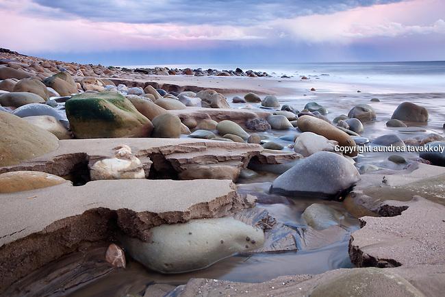 Winter Evening on a rocky beach where the stream meets the ocean on the Gaviota Coast at Sunset