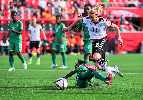 07.06.2015. Lansdowne Park, Ottawa, Canada. Forward Alexandra Popp (#18) of Germany tries to evade a sliding challenge during the FIFA 2015 Women's World Cup Group B match between Germany and Ivory Coast  at Lansdowne Park in Ottawa, Canada.