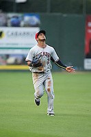Hickory Crawdads left fielder Eduard Pinto (2) tracks a fly ball during the game against the Kannapolis Intimidators at CMC-Northeast Stadium on April 17, 2015 in Kannapolis, North Carolina.  The Crawdads defeated the Intimidators 9-5 in game one of a double-header.  (Brian Westerholt/Four Seam Images)