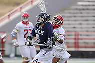 College Park, MD - February 25, 2017: Maryland Terrapins Isaiah Davis-Allen (26) hits Yale Bulldogs Lucas Cotler (9)during game between Yale and Maryland at  Capital One Field at Maryland Stadium in College Park, MD.  (Photo by Elliott Brown/Media Images International)