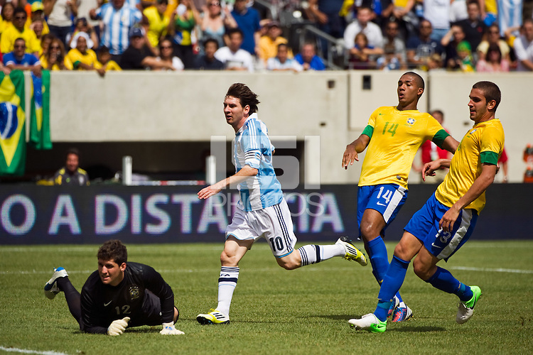Lionel Messi (10) of Argentina (ARG) watches as his shot goes in. Argentina defeated Brazil 4-3 in an international friendly at MetLife Stadium in East Rutherford, NJ, on June 9, 2012.