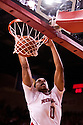27 December 2011: Toney McCray #0 of the Nebraska Cornhuskers dunks the ball against the Wisconsin Badgers during the first half at the Devaney Sports Center in Lincoln, Nebraska. Wisconsin defeated Nebraska 64 to 40.
