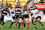 Nigel Watson has the attention of Tivaini Fomai & Wirihana Raihania during the Air New Zealand Cup rugby game between Counties Manukau & Hawkes Bay played at Mt Smart Stadium, 30th of September 2006. Hawkes Bay won 30 - 29.