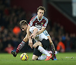 West Ham's Mark Noble tussles with Manchester United's Luke Shaw<br /> <br /> Barclays Premier League- West Ham United vs Manchester United  - Upton Park - England - 8th February 2015 - Picture David Klein/Sportimage