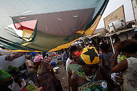 Ghanaians shop while awaiting for the 50th anniversary of their countries' independence in the main market of  Accra, Ghana on Monday March 05 2007..