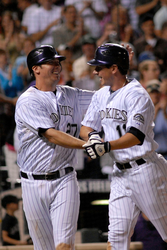 06 June 08: Colorado Rockies 3rd baseman Garrett Atkins (27) congratulates outfielder Brad Hawpe (11) after both players scored on a Hawpe homerun in the 8th inning of a game against the Milwuakee Brewers. The Rockies defeated the Brewers 6-4 at Coors Field in Denver, Colorado on June 6, 2008. FOR EDITORIAL USE ONLY. FOR EDITORIAL USE ONLY