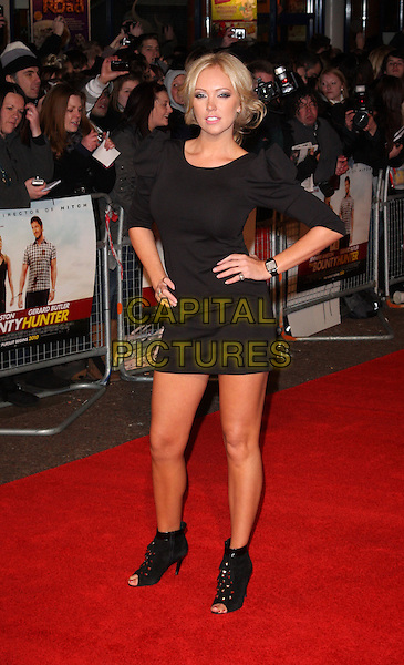 AISLEYNE HORGAN-WALLACE.Attending 'The Bounty Hunter'  UK film premiere at the Vue West End,cinema Leicester Square, London, England, UK,.11th March 2010.arrivals full length black dress hands on hips shoulder puff puffy ruched sleeve sleeves open toe shoes ankle boots booties studs studded bare legs wrist watch .CAP/ROS.©Steve Ross/Capital Pictures