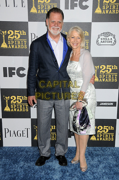 TAYLOR HACKFORD & DAME HELEN MIRREN.25th Annual Film Independent Spirit Awards - Arrivals held at the Nokia Event Deck at L.A. Live, Los Angeles, California, USA..March 5th, 2010.full length husband wife couple married grey gray jacket trousers white silver dress shrug cardigan bag clutch peep toe shoes .CAP/ADM/BP.©Byron Purvis/AdMedia/Capital Pictures.