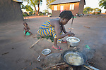 A woman cooks food in the Rhino Refugee Camp in northern Uganda. As of April 2017, the camp held almost 87,000 refugees from South Sudan, and more people were arriving daily. About 1.8 million people have fled South Sudan since civil war broke out there at the end of 2013. About 900,000 have sought refuge in Uganda.