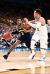 SAN ANTONIO, TX - APRIL 02:  Zavier Simpson #3 of the Michigan Wolverines drives to the basket against Jalen Brunson #1 of the Villanova Wildcats in the 2018 NCAA Men's Final Four National Championship game at the Alamodome on April 2, 2018 in San Antonio, Texas.  (Photo by Brett Wilhelm/NCAA Photos via Getty Images)