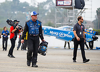 Nov 12, 2017; Pomona, CA, USA; NHRA funny car driver Tommy Johnson Jr walks from his car after going into the sand trap during the Auto Club Finals at Auto Club Raceway at Pomona. Mandatory Credit: Mark J. Rebilas-USA TODAY Sports