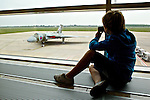 Pix: Shaun Flannery/shaunflanneryphotography.com...COPYRIGHT PICTURE>>SHAUN FLANNERY>01302-570814>>07778315553>>..24th April 2011.............Vulcan XH558 public viewing gallery at Robin Hood Airport Doncaster Sheffield..A young boy takes a photograph of the iconic aircraft.