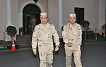 Egypt's army chief Field Marshal Abdel Fattah al-Sisi (L) walks with Gen. Sidqi Sobhi (R) after meeting with members of the Supreme Council of the Armed Forces, in Cairo March 26, 2014. Egypt's military leadership was presenting Field Marshal Abdel Fattah al-Sisi's resignation from his post of defence minister at a meeting with the interim head of state on Wednesday, the state-run Al-Ahram newspaper reported on its website. Sisi is required to step down from his positions in the military in order to mount a widely expected bid for the presidency, which he is forecast to win easily in a forthcoming election. apaimages/Military Moral Affairs