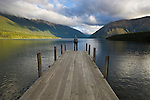 Woman standing on wooden pier at Lake Rotoiti, Nelson Lakes National Park, South Island, New Zealand ----Model Released