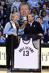 16 November 2014: UNC athletic director Bubba Cunningham (right) presents a Hall of Fame jersey to head coach Sylvia Hatchell (left) in honor of her induction to the Naismith Basketball Hall of Fame. The University of North Carolina Tar Heels hosted the University of California Los Angeles Bruins at Carmichael Arena in Chapel Hill, North Carolina in a 2014-15 NCAA Division I Women's Basketball game. UNC won the game 84-68.