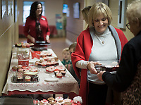 NWA Democrat-Gazette/CHARLIE KAIJO Marinell Adair of Bentonville buys cupcakes during a cupcake fundraiser, Sunday, February 10, 2019 at the First United Methodist Church in Bentonville. <br />