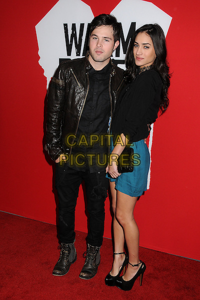 "Cody Longo & guest.""Warm Bodies"" Los Angeles Premiere held at the Cinerama Dome, Hollywood, California, USA..January 29th, 2013.full length black brown leather jacket shirt trousers blue dress side clutch bag.CAP/ADM/BP.©Byron Purvis/AdMedia/Capital Pictures."