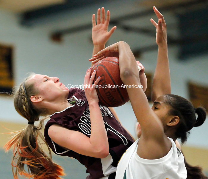 Waterbury, CT-22 February 2012-022212CM11-  Torrington's Nicole Kozlak (left) has her shot blocked by Holy Cross' Briana Bradford (right) during the girls NVL championship game Wednesday night in Waterbury.  Cross won 57-54 to capture the league title.      Christopher Massa Republican-American