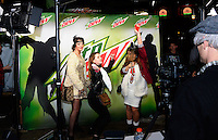 People dance at the Mountain Dew Bust-A-Move Video Booth at Freakfest 2015 on State Street in Madison, Wisconsin