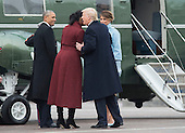 United States President Donald Trump talks to former First Lady Michelle Obama as he escorts her and former President Obama to a helicopter to depart the inauguration, on Capitol Hill in Washington, D.C. on January 20, 2017. President-Elect Donald Trump was sworn-in as the 45th President.    <br /> Credit: Kevin Dietsch / Pool via CNP