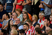 Lincoln City fans watch their team in action<br /> <br /> Photographer Chris Vaughan/CameraSport<br /> <br /> The EFL Sky Bet League One - Lincoln City v Bristol Rovers - Saturday 14th September 2019 - Sincil Bank - Lincoln<br /> <br /> World Copyright © 2019 CameraSport. All rights reserved. 43 Linden Ave. Countesthorpe. Leicester. England. LE8 5PG - Tel: +44 (0) 116 277 4147 - admin@camerasport.com - www.camerasport.com